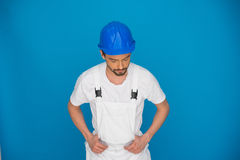 Workman in a blue hardhat Stock Image