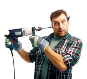 Workman boring his ear royalty free stock photography