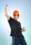 Workman with bottle Stock Image