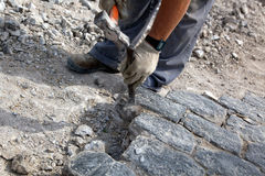 Workman breaking stones Stock Photo