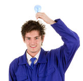 Workman with a bulb. A workman holding a lightbulb above his head, isolated on white Stock Image