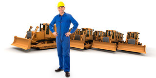Workman and bulldozers. Workman and a group of yellow bulldozers Stock Photo