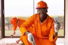 Workman chisel hammer Royalty Free Stock Image