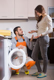 Workman and client near washing machine Stock Photography