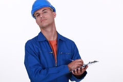 Workman with a clipboard Royalty Free Stock Photo