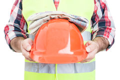 Workman in closeup holding protection helmet and gloves Royalty Free Stock Image