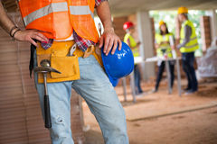 Workman communicating with walkie talkie Stock Image