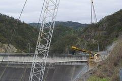 Workman, Dam Upgrade, Kangaroo Creek Reservoir, Adelaide Hills,. Adelaide Hills, SA, Australia - Sep 10, 2016: Work man in a crane workbox suspended by the crane stock photo