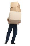 Workman delivers the heavy parcel. Of three boxes, isolated, white background Royalty Free Stock Image