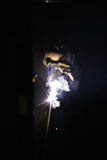 Workman doing welding Stock Images