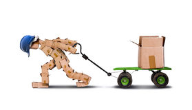 Workman dragging large load Stock Images