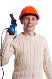 Workman with drill. Workman in red helmet with drill Royalty Free Stock Photography