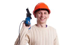 Workman with drill. Workman in red helmet with drill Royalty Free Stock Images