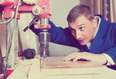 Workman drilling planks Stock Images