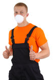 Workman with a dust mask. A workman wearing a dusth mask, isolated on white Royalty Free Stock Photography