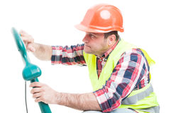 Workman fixing the grass trimming machine. Workman or builder fixing the grass trimming machine isolated on white background Stock Images
