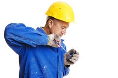 Workman fixing mobile phone Stock Photo