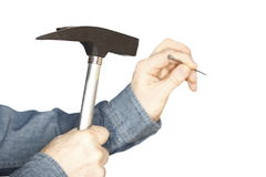 Workman is fixing a nail Royalty Free Stock Photography