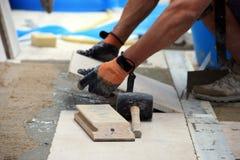 Workman on flooring. (job paving Royalty Free Stock Photo