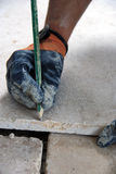 Workman on flooring Stock Image