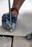 Workman on flooring. (job paving Stock Image