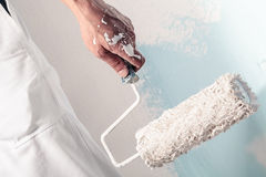 Workman Hand holding Dirty Paintroller Royalty Free Stock Images