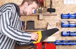 Workman with handsaw. Portrait of a workman holding handsaw Stock Photo