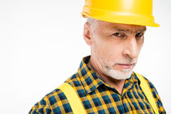 Workman in hard hat. Close-up portrait of mature workman in hard hat looking at camera Royalty Free Stock Image