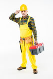 Workman in hard hat. Mature workman in hard hat holding tool kit and looking at camera on white Stock Photography