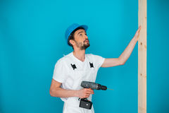 Workman in a hardhat holding a drill Stock Photos