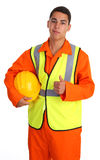 Workman with a hat. A workman smiling holding a hard hat Stock Photography
