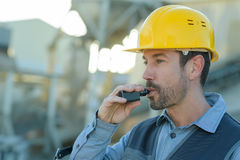 Workman having break and smoking cigarette Stock Image