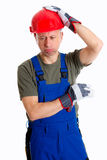 Workman with helmet thinking Royalty Free Stock Photos