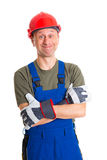 Workman with helmet. Young workman in blue dungarees and red hard top Stock Photos