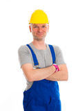 Workman with helmet. Young workman in blue dungarees and yellow hard top Stock Photos