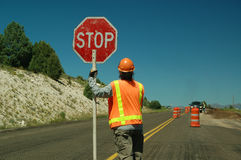 Workman holding stop sign Royalty Free Stock Image