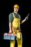 Workman holding tool kit Stock Images