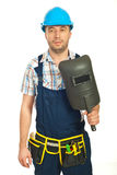 Workman holding welding mask Stock Photo