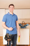 Workman Installing Fitted Kitchen Royalty Free Stock Photos