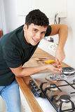 Workman Installing Gas Cooker In New Kitchen stock image
