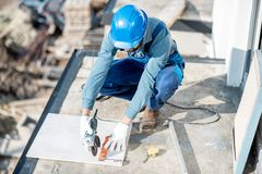 Workman laying tiles on the balcony royalty free stock photography
