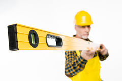 Workman with level tool Stock Photo