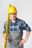 Workman with level tool Royalty Free Stock Image