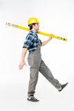 Workman with level tool Stock Image
