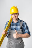 Workman with level tool Royalty Free Stock Photos
