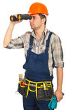 Workman looking through binocular Royalty Free Stock Photography