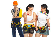 Workman looking to two sexy workers women Royalty Free Stock Photos