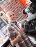 Workman making duplicates of keys Stock Image