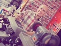 Workman making duplicates of keys Royalty Free Stock Photo