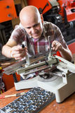 Workman making mailbox plate in workshop Royalty Free Stock Photography